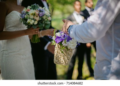 guests give presents to the newlyweds at the wedding ceremony. guest giving bouquet to bride and groom. soft focus
