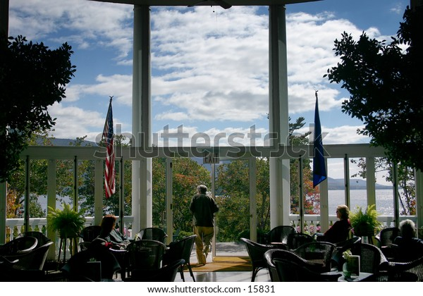 Guests relax at the exclusive Sagamore resort in the Adirondacks at Fall.