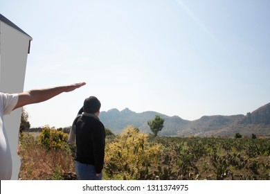 Guide hand pointing to point of interest on speaker's hill in state of Mexico
