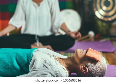 Guided meditation. Close up on woman's hand, meditating, sitting in lotus position.