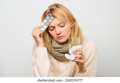 Guidelines for treating fever. Best fever reducer. Girl suffer headache and take medicine. Headache and fever remedies. Take medications to reduce fever. Woman tousled hair scarf hold tablets blister.