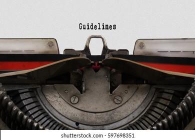 Guidelines word typed on a vintage typewriter.