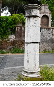 Guidepost at the junction of Via di Porta San Sebastiano (Via Appia/Appian Way) and Via di Porta Latina, on which the street names are inscribed, Rome, Italy