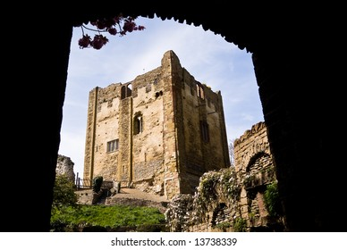 Guildford castle framed by an arch
