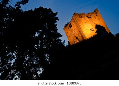 Guildford Castle at Night with copy space, oblique composition to show tension.