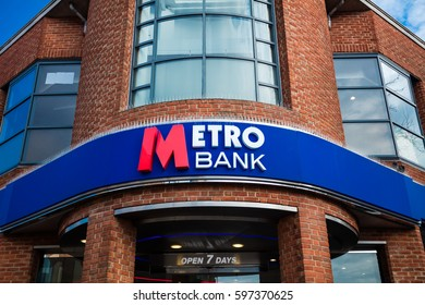 GUILDFORD, ENGLAND, 15 FEBRUARY, 2017: The sign above the entrance to the Metro Bank in Reading, England. Started in 2010, Metro Bank is Britain's first new High Street bank in over 100 years