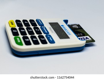 Guildford, UK - August 23rd 2018: A close-up of the Barclays PINsentry and VISA card, on 23rd August 2018.