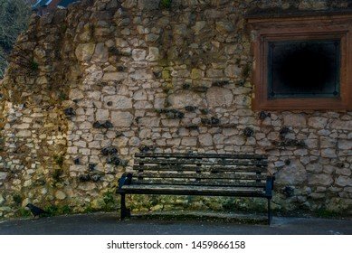 Guildford, UK -  Feb 18, 2019 : In front of a stone wall on Guildford Castle