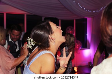 Guildford, UK - September 2015: A Girl Sings Enthusiastically at a Wedding