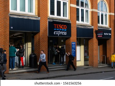 Guildford, United Kingdom - November 06 2019:   The entrance to the Tesco Express store on Bridge Street