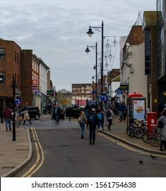 Guildford, United Kingdom - November 06 2019:   Shoppers walking along North Street