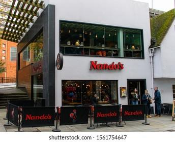 Guildford, United Kingdom - November 06 2019:   The entrance to Nandos Restaurant Guildford on Friary St