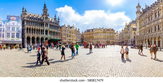 Guildhalls on the Grand Place in Belgium, Brussels. People walking around on the square.