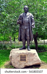 Guilford, Connecticut - July 10, 2015::  Statue of Rev. Henry Whitfield (1590-1657) by sculptor Robert Shure in the garden of his historic 1639 stone house  *