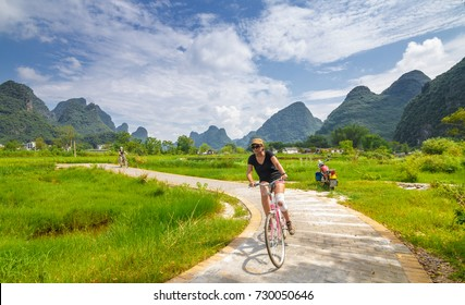 GUILIN, CHINA - AUG 26:Cycling tourists on Aug 26, 2017 in Yangshuo Guilin,Yangshuo is a beautiful place.