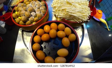 GUILIN, CHINA - CIRCA NOVEMBER 2018 : Close up shot of ROTATING FOOD at BUFFET STYLE CONVEYOR BELT RESTAURANT.