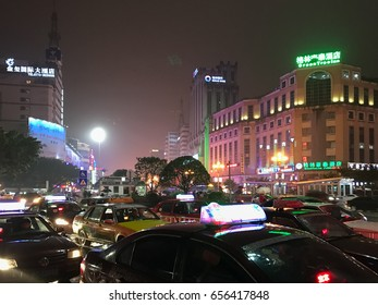 GUILIN, CHINA - MARCH 21, 2017: night traffic on street of Guilin city in spring. The city is in the northeast of China's Guangxi Zhuang Region, there are about 4,8 mln inhabitants