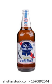 Guilin China March 30, 2020 Pabst Blue Ribbon is a very popular American Lager beer in China.  Isolated on a white background