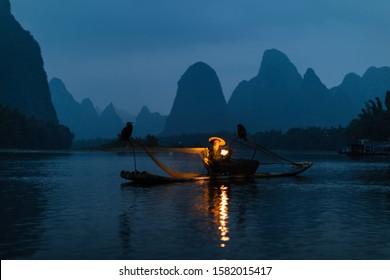 Guilin city in China: November 2019: Traditional Cormorant fisherman