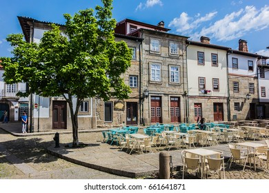 GUIMARAES, PORTUGAL - APRIL19, 2017: View of Praca de Santiago (Praca Sao Tiago) in old town of Guimaraes. Traditional Medieval houses, outdoor restaurant and cafe.