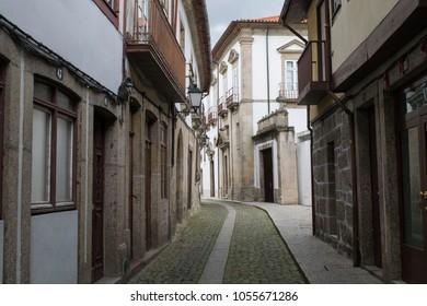 GUIMARAES, PORTUGAL - CIRCA APRIL 2017: Empty historic streets of the Old Quarter in Guimaraes