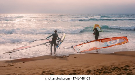 Guincho beach, Portugal - May 30, 2020: Windsurfers at the famous Guincho beach in Cascais, Portugal