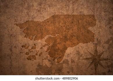 guinea bissau map on a old vintage crack paper background