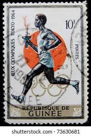 GUINEA - CIRCA 1964: A post stamp printed in Guinea shows runner, circa 1964.