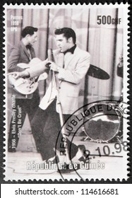 GUINEA - CIRCA 1998. A postage stamp printed by GUINEA shows image portrait of famous American singer Elvis Presley (1935-1977), circa 1998.