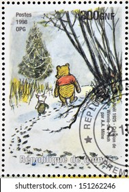 GUINEA - CIRCA 1998: a stamp printed in Republic of Guinea commemorates the creation of Winnie the Pooh by Milne, circa 1998.
