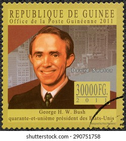 GUINEA - CIRCA 2011: A stamp printed in Guinea shows David Hackett Souter (1934-2012), Associate Justice of the Supreme Court of US, series George H. W. Bush forty-first President of US, circa 2011