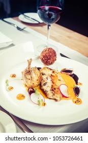 Guinea fowl, pumpkin puree, fried buckwheat, gravy sauce served in a restaurant