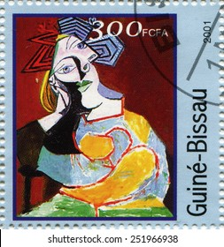 """guinea-bissau - CIRCA 2001: A stamp printed in guinea-bissau shows paint by Pablo Picasso """"woman accoud��?e"""", circa 2001"""