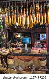 Guipuzcoa, Basque Country, Spain - august 11, 2018: Young storekeeper inside a store specializing in cold meats and hams, in the urban center of the city of San Sebastian