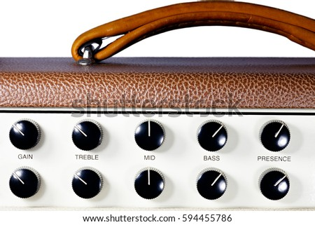Guitar amp control knobs detail on a pure white background, including gain, treble, mid, bass, presence and leather handle.