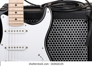 Guitar with amplifier and audio cord with jack closeup isolated on white background