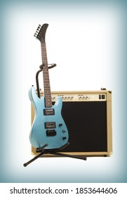 guitar amplifier and electricguitar on gradient background