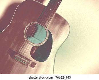 Guitar. Background in watercolor painting style.Musical instruments have 6 lines. Play for entertainment