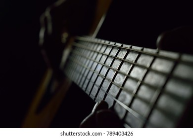 Guitar in a black room