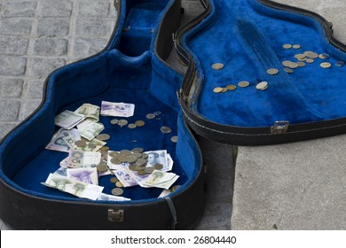 Guitar case with money in it