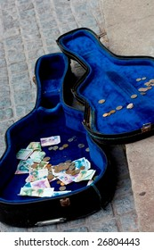 Guitar case on the street with money in it