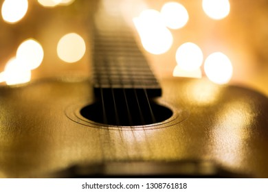 Guitar closeup on the background of lights.