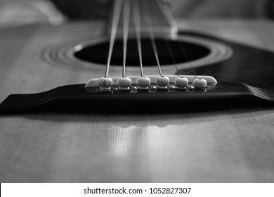Guitar closeup of the pins and strings in black and white