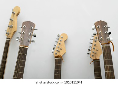 guitar closeup in the studio,Neck of a guitar with strings and head in the background,Musical instrument,Vintage colors,Detail of acoustic guitar,wooden guitar,