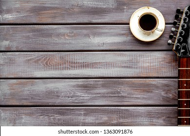 guitar and coffee for song writer on wooden background top view space for text