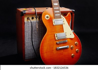 Guitar combo with guitar on the black background.