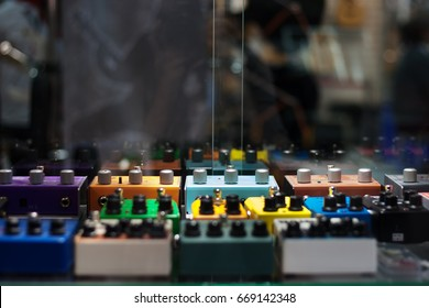Guitar effects pedals on the showcases in the music shop
