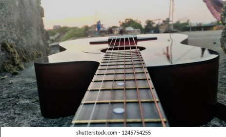 Guitar and fretboard/fingerboard abstrct