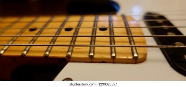 guitar fretboards closeup