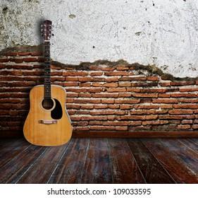 Guitar in grunge room.